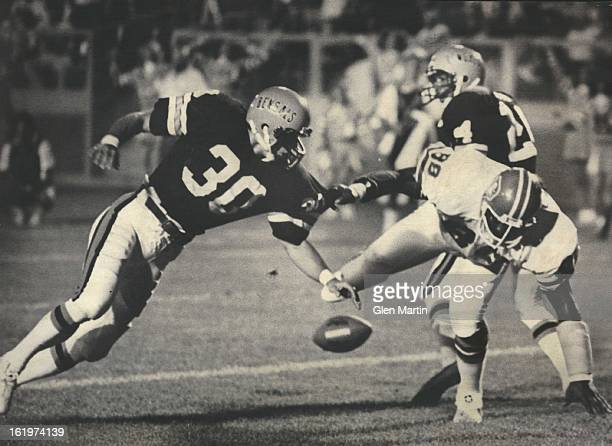 As Ball Falls Harmlessly to the Ground, so do Riley Odoms and Dick Jauron; Matt Robinson's pass fell between Denver's Odoms and the Bengals' Jauron...