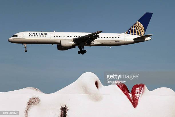 As Boeing 787 Dreamliner jets operated by United Airlines and other carriers are grounded a United Airlines 757 passes a billboard on approach to Los...