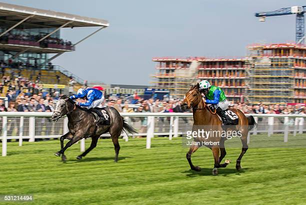 As building work continues Smuggler's Moon ridden by Jimmy Fortune gets the better of Gunmetal ridden by Michael Murphy to win The Coolmore Stud...