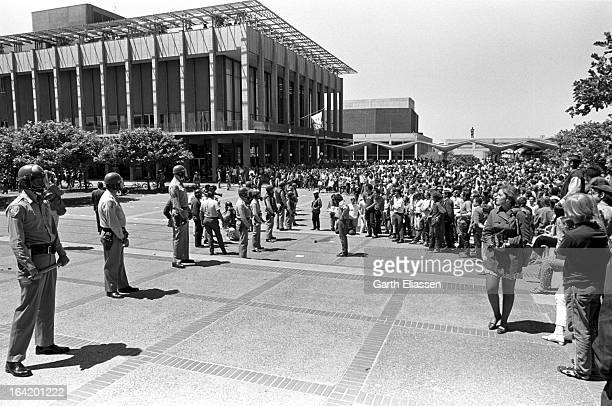 As California Highway Patrolmen, in helmets and gas masks, stand guard as students and activists assemble in Spoul Plaza on the campus of the...