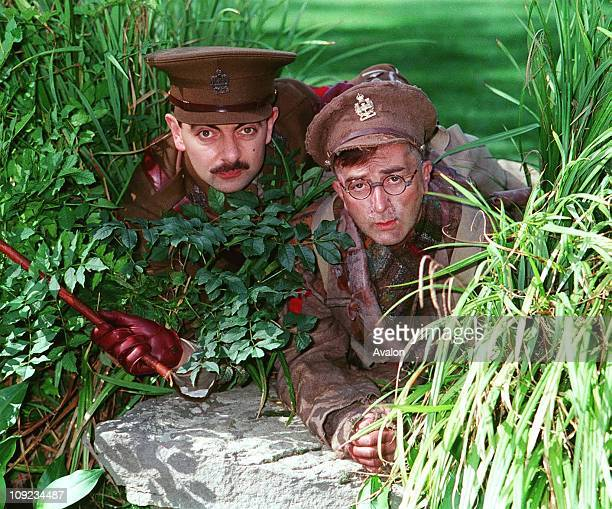 As Captain Blackadder Rowan Atkinson and Right TONY ROBINSON As Private Baldrick British Actors Stars of the BBC TV series 'Blackadder' Stars of the...