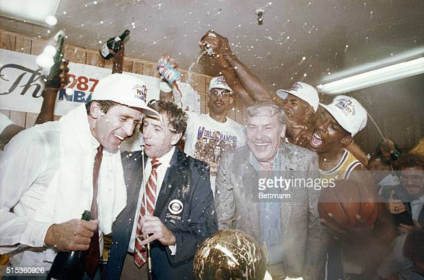 As CBS commentator Brent Musburger tries to interview Laker coach Pat Riley and Laker owner Jerry Buss Lakers Kareem AbdulJabbar Billy Thompson and...