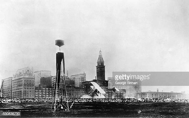 As Chicago looked in 1911 this scene snapped at the 1911 Chicago Air Meet a Wright pusher is shown rounding a pylon against the sky line of Michigan...