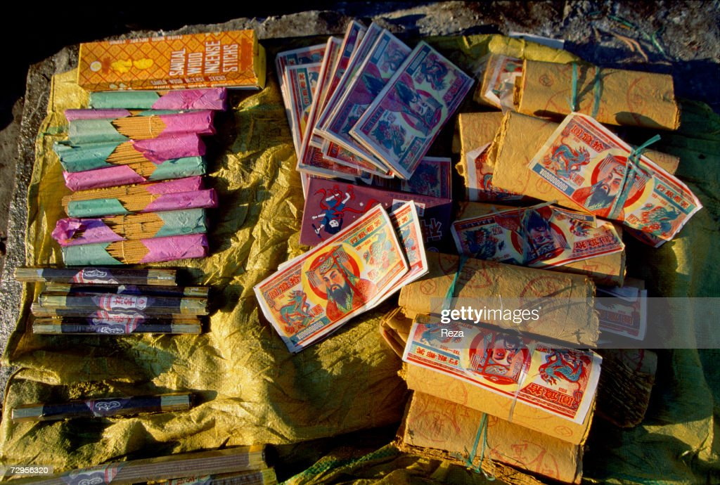 as chinese new year approaches incense and bundles of fake notes are sold on february - Chinese New Year 1999