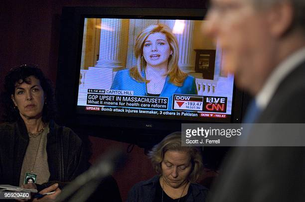 As CNN airs coverage of the election results Senate Minority Leader Mitch McConnell RKy right speaks during a news conference on Republican Scott...