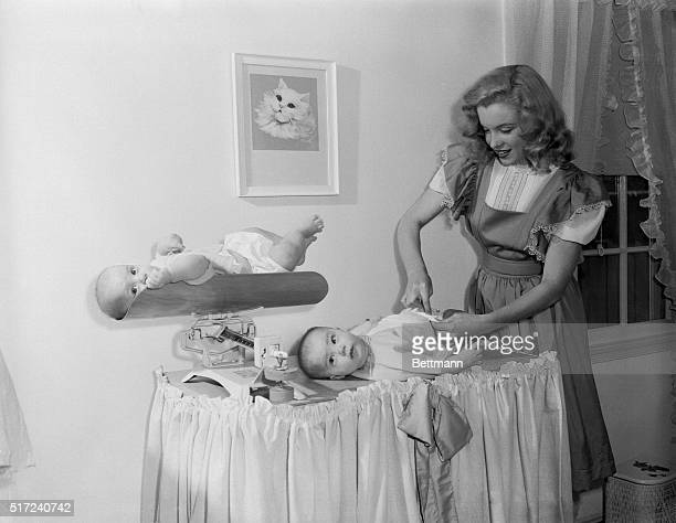 As contented a pair of babies as one would hope to see And why not with cute 18yearold Marilyn Monroe as their baby sitter Marilyn was saving the...