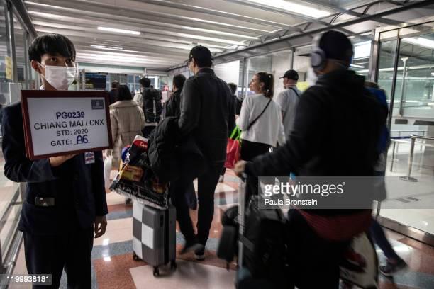 As Coronavirus spreads travelers arriving and departing wear masks at Suvarnabhumi International airport in Bangkok, Thailand on February10, 2020....