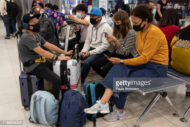 As Coronavirus spreads travelers arriving and departing wear masks at Suvarnabhumi International airport in Bangkok Thailand on February10 2020 The...