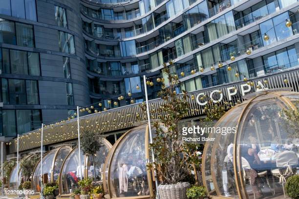 As Covid lockdown restrictions continue to ease and non-essential businsses re-open, customers enjoy al fresco dining at 'Coppa Club', a riverside...