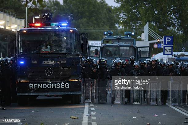 As darkness falls after clashes with migrants Hungarian police hold the line at the border on September 16 2015 in Horgos Serbia Hungary has...