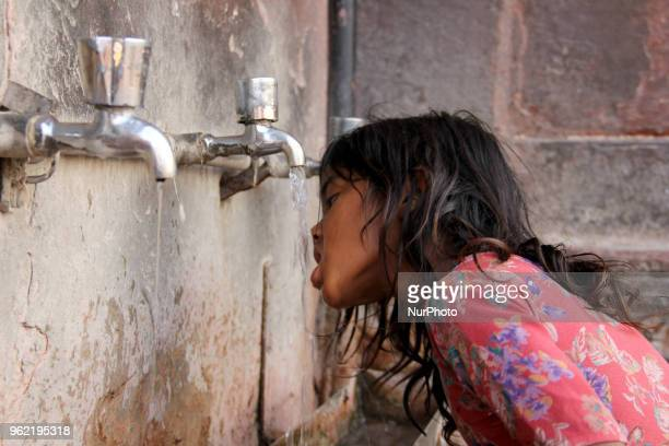 As Delhi Bolisa girl can be seen quenching his thirst in Delhi India on 24 May 2018 Heat wave to continue across northern central India for four days...