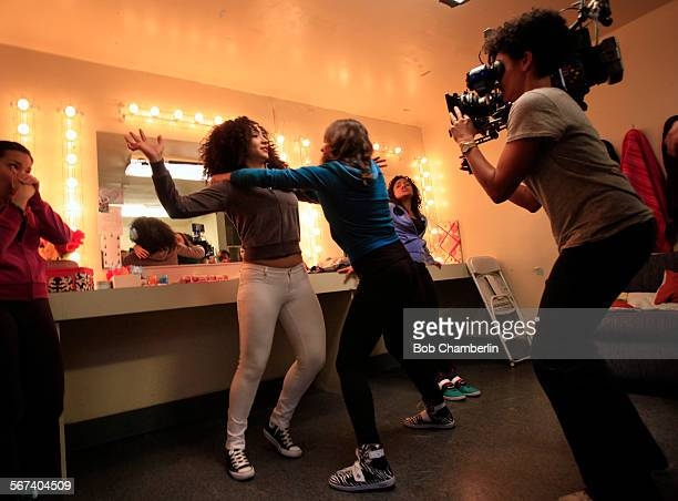 As Director of Photography Kira Kelly right films them Monica Ramirez Yvonne left and Vannessa Vasquez Camilla right rehearse a fight scene where...