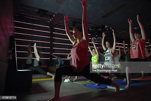 As early as 6 am dozens of yoga and rave enthusiast start their morning workout before dancing under the motto 'raving before coffee' during...