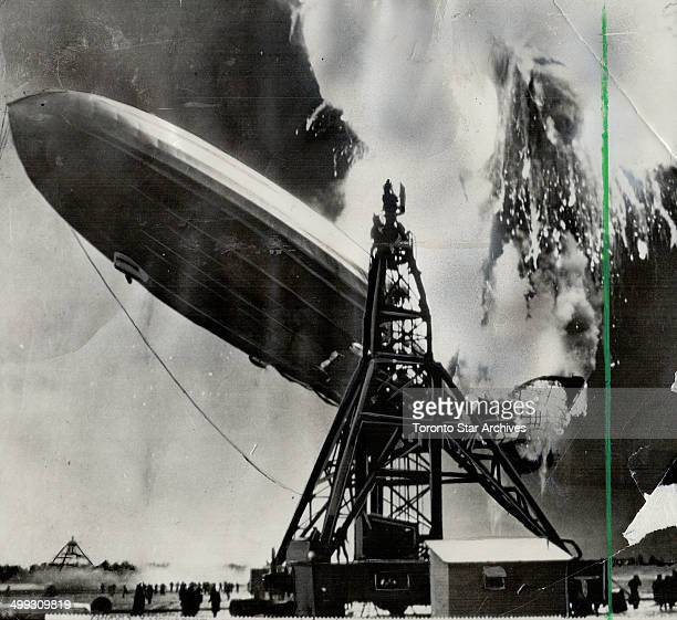 As explosion enveloped giant dirigible in flames Silhouetting the steel girders of the mooring mast which she never reached the flameenveloped...