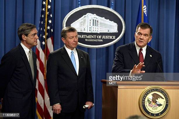 As FBI Director Robert Mueller, left, and Attorney General John Ashcroft, center, look on, Homeland Security Secretary Tom Ridge announces that the...