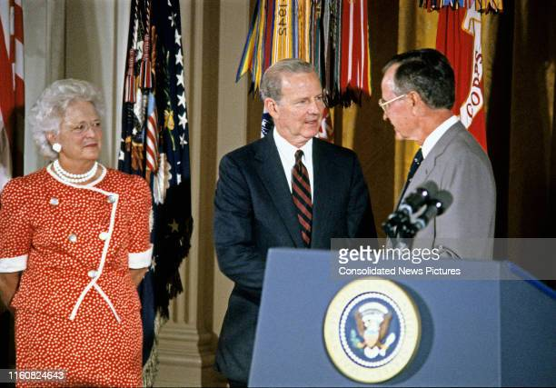 As First Lady Barbara Bush watches US Secretary of State James A Baker III is awarded the Presidential Medal of Freedom by US President George HW...