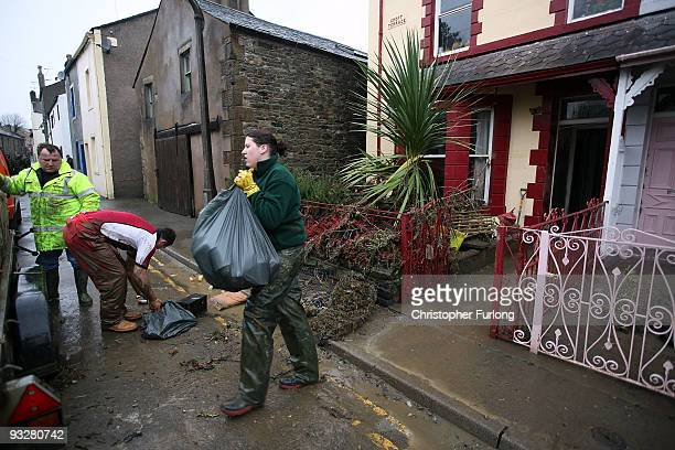 As flood water recedes the big clean up of debris and damage begins for the people of Cockermouth on November 21, 2009 in Cockermouth, United...