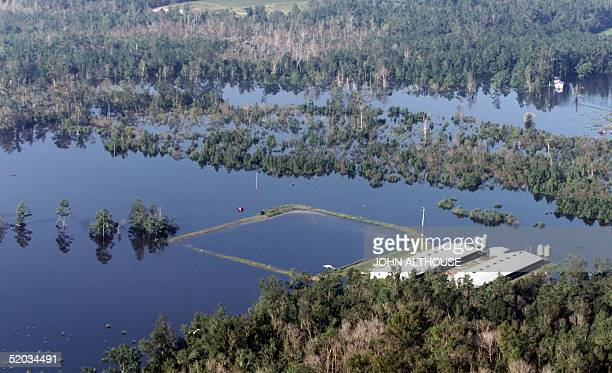 As flood waters from Hurricane Floyd begin to recede Saturday 18 September 1999 environmental and health concerns have become obvious such as this...