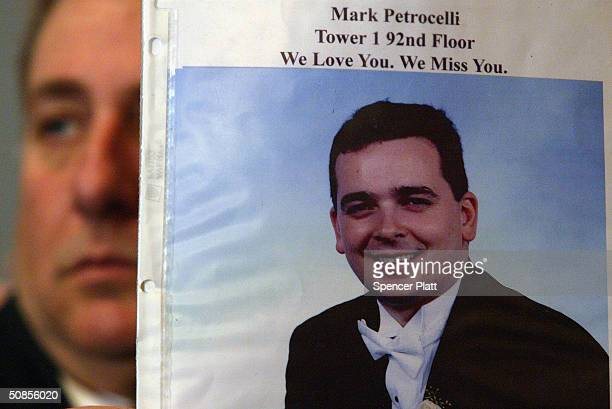 As former New York City Mayor Rudolph Giuliani testifies Al Petrocelli holds up a picture of his son Mark who was killed on September 11 at a public...