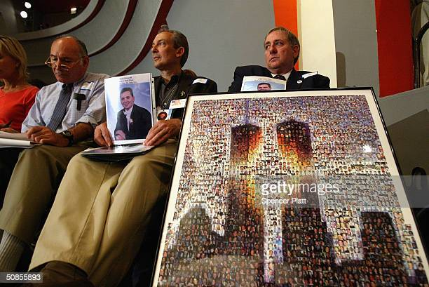 As former New York City Mayor Rudy Giuliani testifies relatives of Mark Petrocelli who was killed on September 11 hold up pictures at a public...