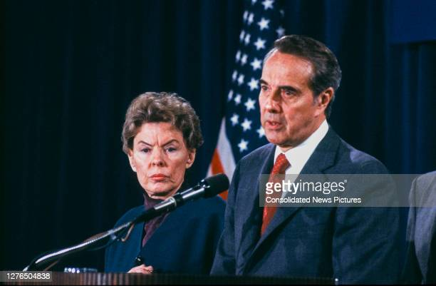 As former US Ambassador to the United Nations Jeane Kirkpatrick watches, politician and US Senate Minority Leader Bob Dole speaks at a press...
