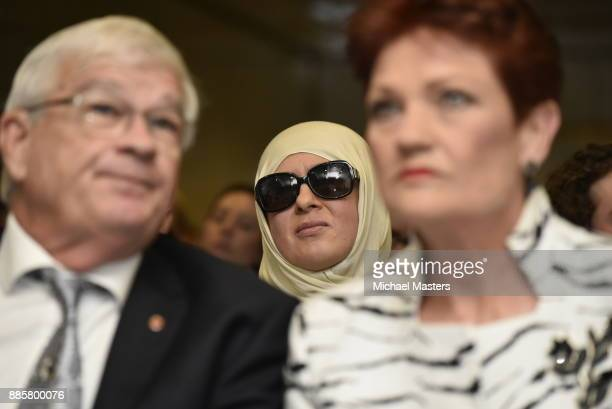 As guest listens behind Senator Pauline Hanson and Senator Brian Burston as Milo Yiannopoulos speaks during an event hosted by senator David...
