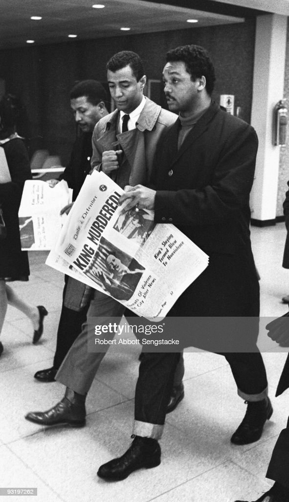 As he walks through O'Hare Airport, American Civil Righter leader and minister Jesse Jackson holds a copy of the Daily Defender newspaper, which features the headline 'King Murdered!' early April, 1968. The headline refers to the assassination of Dr. Martin Luther King Jr on the evening of April 4.