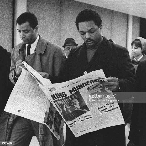As he walks through O'Hare Airport American Civil Righter leader and minister Jesse Jackson holds a copy of the Daily Defender newspaper which...