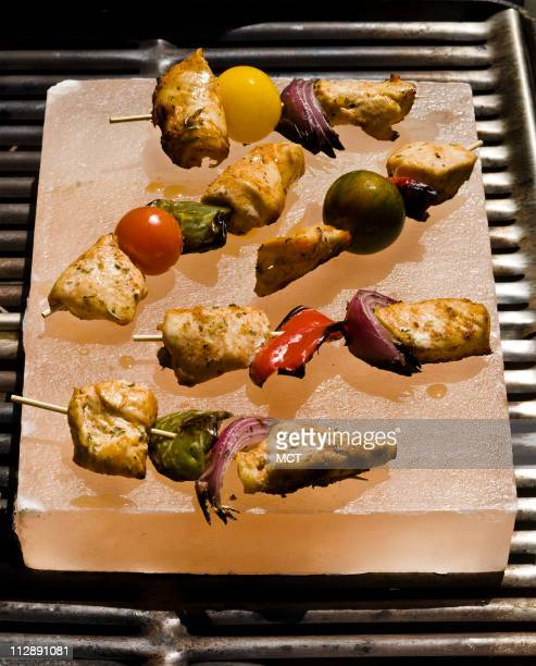 As heavy as a marble slab this Himalayan Salt Plate imported from Pakistan heats up as hot as stone on the grill making it a good if unusual choice...
