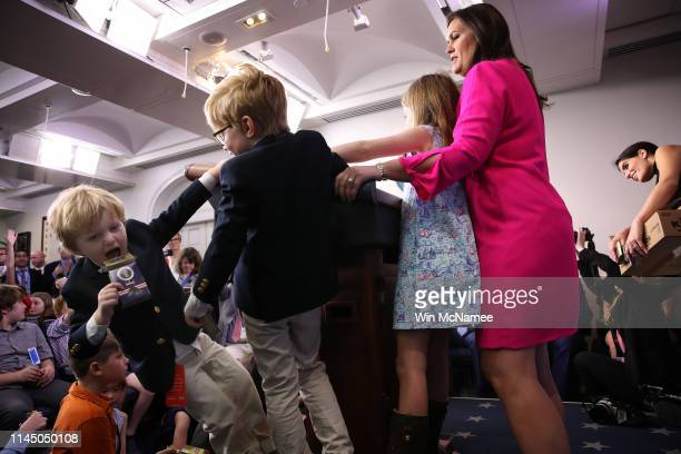 As her children stay close by White House press secretary Sarah Sanders answers questions from children of White House staff and reporters on April...