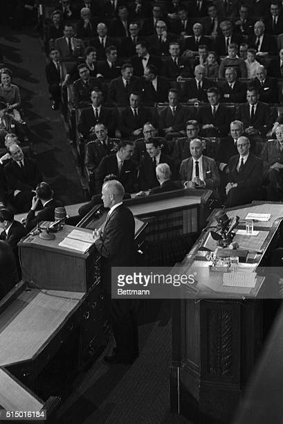 As his fellow astronauts look on Lt Col John H Glenn speaks to a joint meeting of Congress February 26th The astronauts are Alan B Shepard Virgil...