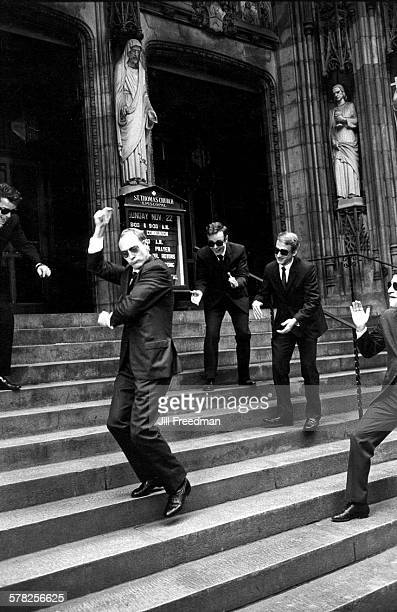 As his friends clap an unidentified man snaps his fingers as he dances on the steps of Saint Thomas Church New York New York November 1971 All the...