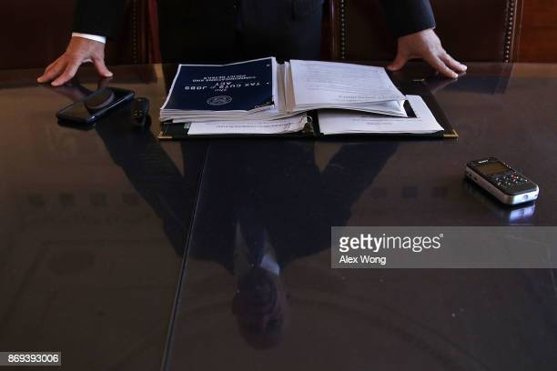 As his reflection is seen on a piece of tabletop glass Chairman of House Ways and Means Committee Rep Kevin Brady speaks during a news briefing on...