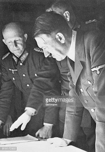 As Hitler Studied the Dismemberment of Poland Somewhere in Poland Fuhrer Adolf Hitler leans over a table on which lies a map of Poland which his army...
