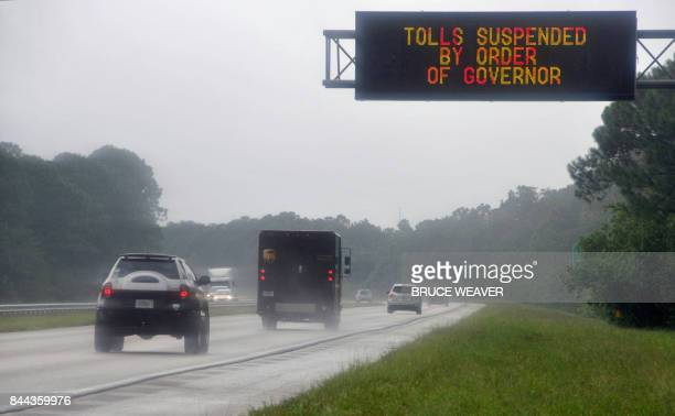 As Hurrcane Irma approaches Florida September 8 2017 a sign on a toll road leading from Cocoa Beach to Orlando alerts drivers that tolls have been...