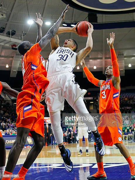 As Ibrahim Djambo of the Clemson Tigers defends Zach Auguste of the Notre Dame Fighting Irish shoots the ball at Purcel Pavilion on February 11 2014...