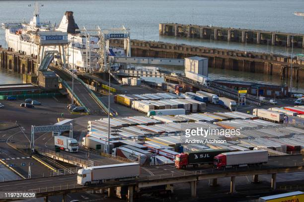 As incoming lorries disembark from the ferry other lorries line up ready for departure inside the Eastern Dock of the Port of Dover is where the...