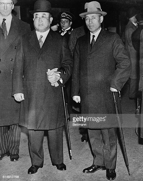 As Japanese Naval Delegation Arrived in London Rear Admiral Yamamoto and his aide pictured as they arrived in London to attend the three cornered...