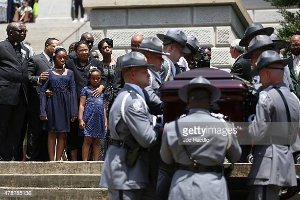 As lawmakers family and friends look on the South Carolina Highway Patrol Honor Guard carry the coffin of church pastor and South Carolina State Sen...