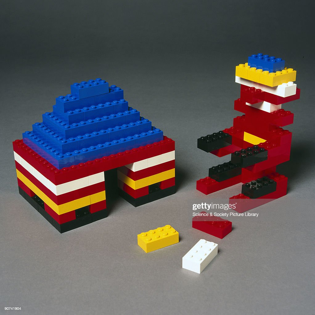 As Lego shapes are complex, casting is the easiest way of producing them. They are injection moulded using a type of plastic called ABS (acrylonitrile butadiene styrene) which is melted and injected into the mould by a hydraulic plunger. This has a force equivalent to 700 bags of sugar balanced on the end of your finger and a single mould can produce 2880 Lego blocks an hour. A house and a 'person' have been constructed from the bricks. Made by the Lego Group.