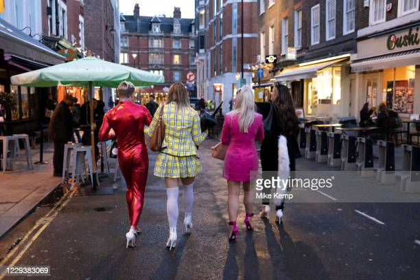 As Londoners await the announcement of a second coronavirus lockdown it's business as usual in the West End with people in outrageous dress for...