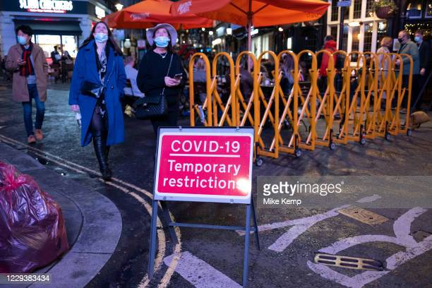 As Londoners await the announcement of a second coronavirus lockdown it's business as usual in the West End with people out socialising outside the...