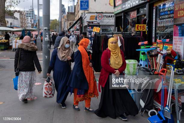 As Londoners from the mainly Bangladeshi Asian community await the second coronavirus national lockdown it's business as usual at Whitechapel Market...