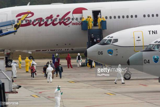 As many as 250 citizens who were evacuated from Wuhan City China got off the plane upon arrival at Hang Nadim Airport Batam Riau Islands Indonesia on...