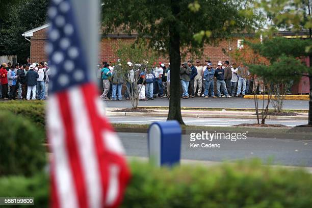 As many as 60 Latino day laborers congregate near a 7Eleven store in Herndon Virginia about 30 miles west of Washington October 13 2005 Like many...