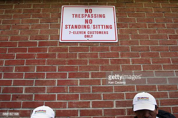 As many as 60 Latino day laborers congregate near a 7Eleven store in Herndon Virginia about 30 miles west of Washington October 13 2005 TheAs many as...