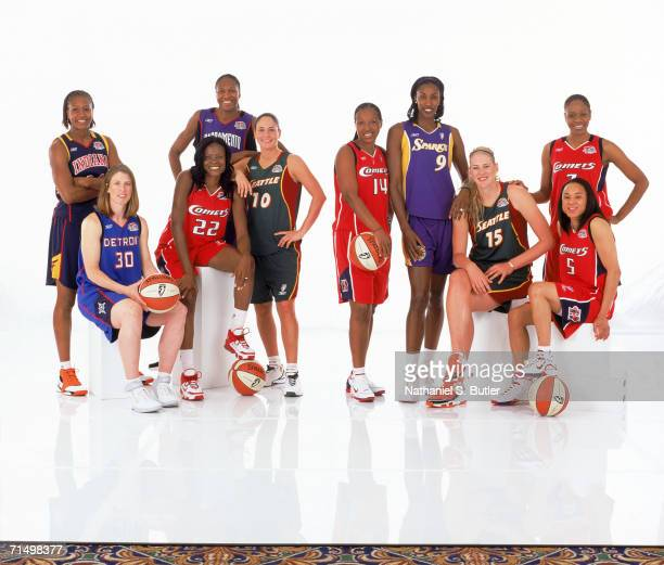 As members of the all decade team standing Tamika Catchings of the Indiana Fever Yolanda Griffith of the Sacramento Monarchs Sue Bird of the Seattle...