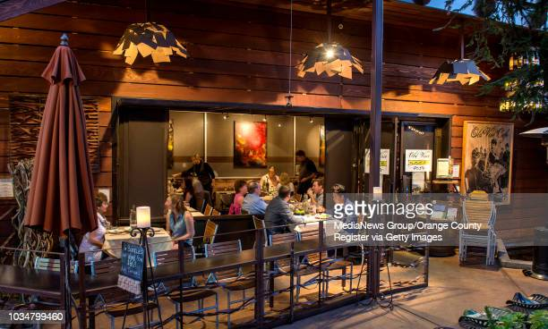 As night falls customers enjoy the atmosphere in both the outdoor and indoor dinning areas at Old Vine Café in Costa Mesa ///ADDITIONAL INFORMATION...