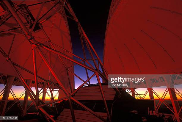 As night falls the dome of astronomical observatory Gemini I also called Gemini North opens where the observatory sits atop the dormant volcano Mauna...