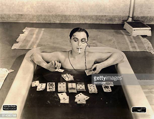 As one of the idle rich, Lupino Lane's character plays solitaire in the bathtub.